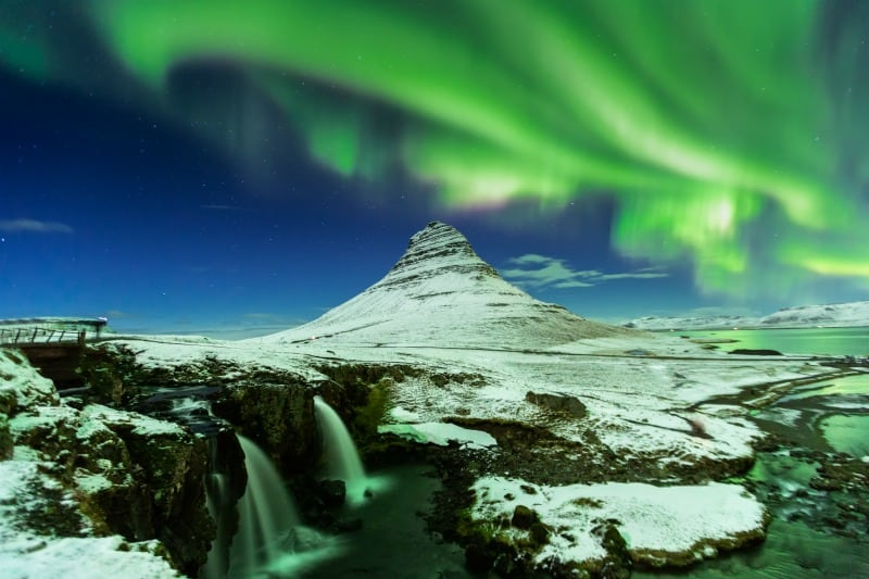 Aurora Borealis or northern light above kirkjufell mountain in iceland